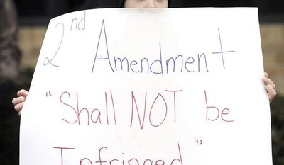 "** FILE ** Matthew Duggan of Dover, Pa., 9, holds a sign as he and his father, Patrick, attend a ""Day of Resistance"" rally in Red Lion, Pa., on Saturday, Feb. 23, 2013, part of a nationwide effort to support the right to bear arms and to oppose some recent gun-control proposals and actions taken in the wake of the mass killing of school children in Newtown, Conn. (AP Photo/York Daily Record, Jason Plotkin)"