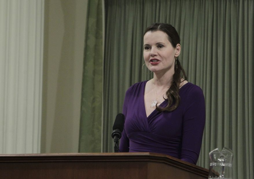 Actress Geena Davis addresses the California Assembly at the Capitol in Sacramento, Calif., on Monday, March 4, 2013. Miss Davis, who is the chairwoman of the Commission on the Status of Women, was one of several women honored for their accomplishments. (AP Photo/Rich Pedroncelli)