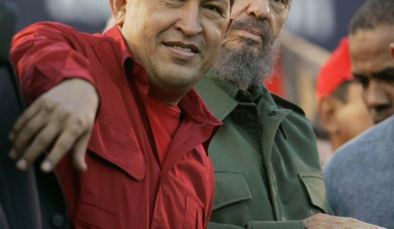 FILE - In this  July 21, 2006 file photo, Venezuela's President Hugo Chavez, left, gestures as Cuba's President Fidel Castro looks on during an event  in Cordoba, Argentina. Venezuela's Vice President Nicolas Maduro announced on Tuesday, March 5, 2013 that Chavez has died at age 58 after a nearly two-year bout with cancer. (AP Photo/Roberto Candia, File)