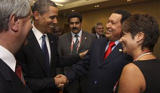 **FILE** President Obama (left) shakes hands with Venezuelan President Hugo Chavez before the opening session of the 5th Summit of the Americas in Port of Spain, Trinidad and Tobago, on April 17, 2009. (Associated Press/Mariamma Kambon, Summit of the Americas)