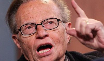 """Larry King talks with host Jamie LaFiego while appearing as a guest on """"Up Late"""" on Thursday, March 1, 2012, at Marshall University in Huntington, W.Va. (AP Photo/The Herald-Dispatch, Mark Webb)"""