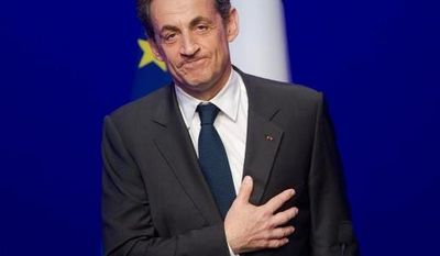 Outgoing French President Nicolas Sarkozy leaves after addressing supporters at his Union for a Popular Movement party headquarters after conceding defeat to Socialist Francois Hollande. (Associated Press)