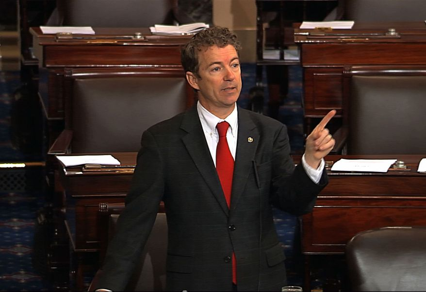 This video frame grab provided by Senate Television shows Sen. Rand Paul, Kentucky Republican, speaking on the floor of the Senate on Capitol Hill in Washington on Wednesday, March 6, 2013. Senate Democrats pushed Wednesday for speedy confirmation of John O. Brennan's nomination to be CIA director but ran into a snag after Mr. Paul began a lengthy filibuster over the legality of potential drone strikes on U.S. soil. (Associated Press/Senate Television)