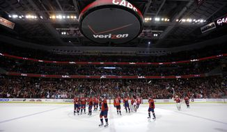 The Washington Capitals celebrate at center ice after an NHL hockey game against the Boston Bruins Tuesday, March 5, 2013 in Washington. The Capitals won 4-3 in overtime. (AP Photo/Alex Brandon)