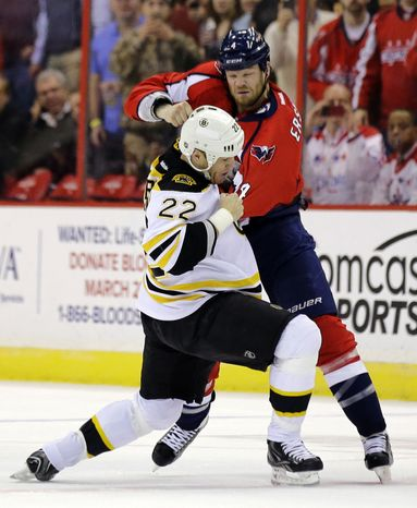 Washington Capitals defenseman John Erskine (4) fights with Boston Bruins right wing Shawn Thornton (22) in the first period of an NHL hockey game, Tuesday, March 5, 2013, in Washington. (AP Photo/Alex Brandon)