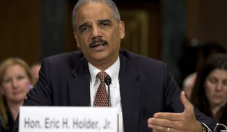 "Attorney General Eric Holder testifies on Capitol Hill in Washington on March 6, 2013, before the Senate Judiciary Committee hearing ""Oversight of the U.S. Department of Justice."" (Associated Press)"