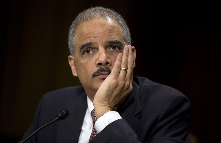 "** FILE ** Attorney General Eric Holder listens as he testifies on Capitol Hill in Washington on March 6, 2013, before the Senate Judiciary Committee hearing ""Oversight of the U.S. Department of Justice."" (Associated Press)"