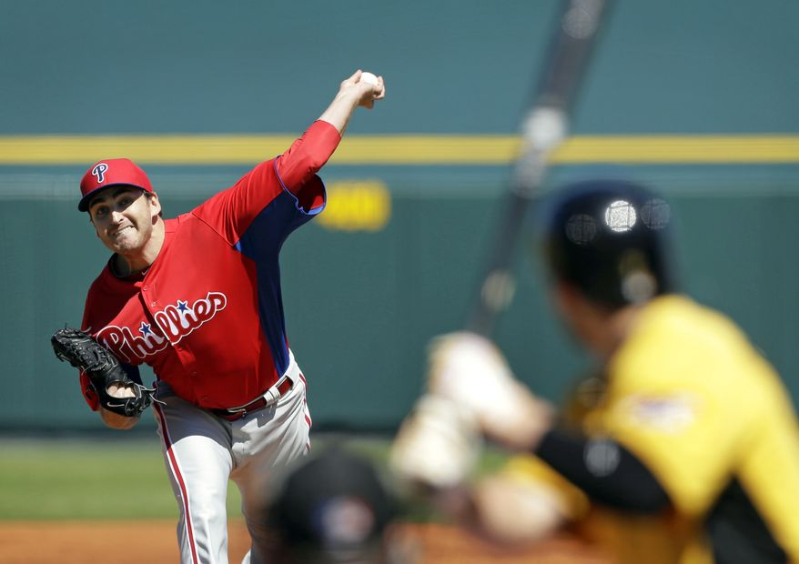 Philadelphia Phillies starting pitcher John Lannan throws during a baseball spring training exhibition game against the Pittsburgh Pirates, Monday, March 4, 2013, in Bradenton, Fla. (AP Photo/Charlie Neibergall)