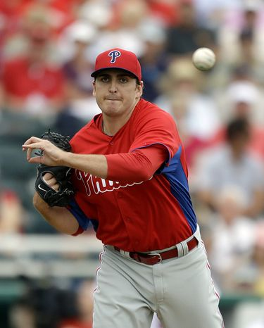 Philadelphia Phillies starting pitcher John Lannan attempts to catch Minnesota Twins' Pedro Florimon, not pictured, leading off first base in the second inning of an exhibition spring training baseball game, Wednesday, Feb. 27, 2013, in Fort Myers, Fla. (AP Photo/David Goldman)
