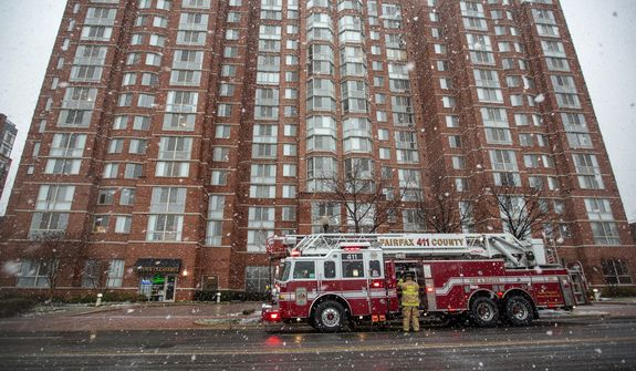Fairfax County firefighters respond to a call in Alexandria, Va., Wednesday, March 6, 2013. (Andrew S. Geraci/The Washington Times)