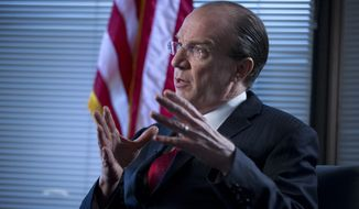 Stuart Bowen, special inspector general for Iraq reconstruction, gestures during an interview in his office in Arlington, Va., on Tuesday, Feb. 19, 2013. (AP Photo/Evan Vucci)