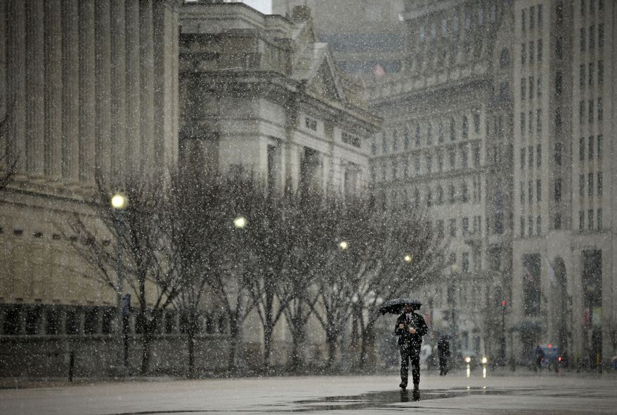 A pedestrian walks up Pennsylvania Avenue Northwest near the White House in Washington on Wednesday, March 6, 2013. Schools, businesses and the federal government closed in anticipation of a snowstorm that could blanket the region. (AP Photo/Pablo Martinez Monsivais)