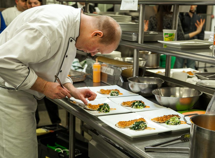 Nathan Bates (left), chef at the New Zealand Embassy, and Roman Shchadrin (below), who cooks for the Embassy of the Russian Federation, will be among the competitors Thursday. (Jason Morenz)