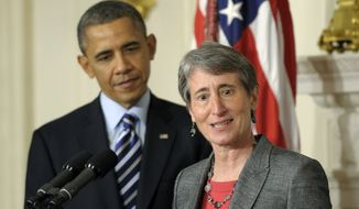 ** FILE ** President Obama listens as his nominee for interior secretary, REI Chief Executive Officer Sally Jewell, speaks in the State Dining Room of the White House in Washington on Wednesday, Feb. 6, 2013. (Associated Press)