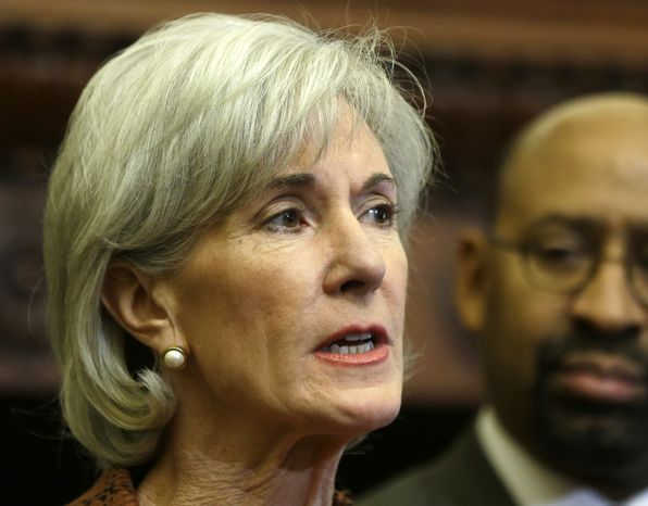 **FILE** Health and Human Services Secretary Kathleen Sebelius, accompanied by Philadelphia Mayor Michael Nutter, speaks Feb. 20, 2013, about the federal health care overhaul during a news conference at City Hall in Philadelphia. (Associated Press)