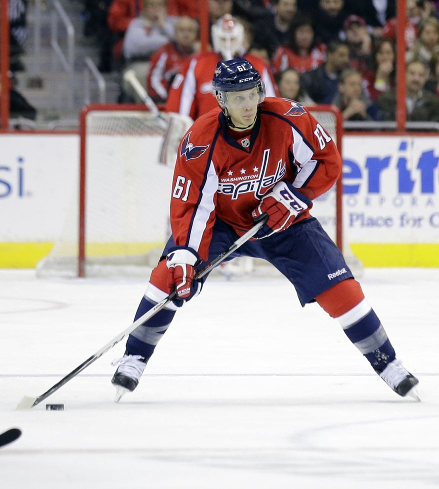 Washington Capitals' Steven Oleksy skates with the puck in the first period of an NHL hockey game against the Boston Bruins Tuesday, March 5, 2013 in Washington. (AP Photo/Alex Brandon)
