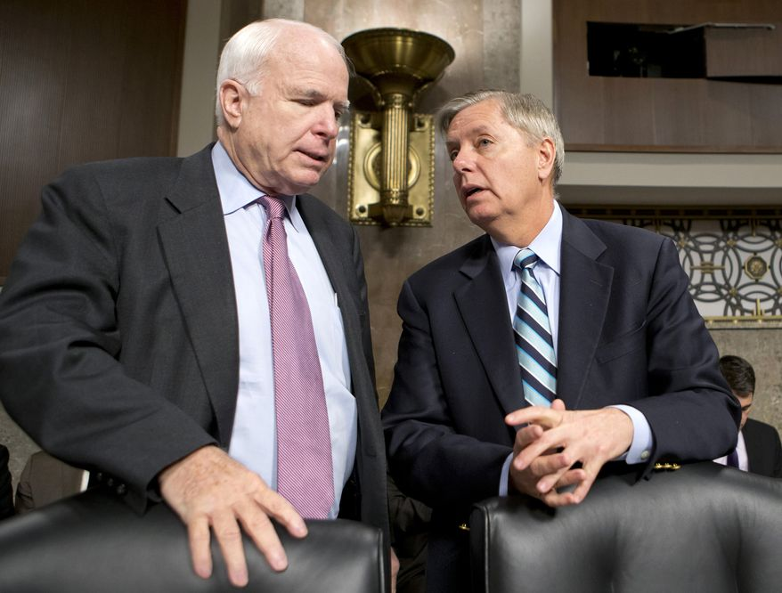 ** FILE ** Republican Sens. John McCain (left) of Arizona and Lindsey Graham of South Carolina confer on Feb. 14, 2013, on Capitol Hill in Washington. (Associated Press)