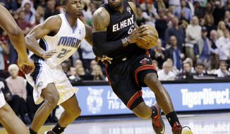 Miami Heat's LeBron James (6) drives around Orlando Magic's DeQuan Jones (20) on his way to shooting the go-ahead layup with 3.2 seconds left in their NBA basketball game in Miami, Wednesday, March 6, 2013. The Heat won 97-96. (AP Photo/J Pat Carter)