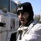Free Syrian Army fighters stand next to United Nations Disengagement Observer vehicles in the southern province of Daraa, Syria, near the Golan Heights, on Wednesday, March 6, 2013, in an image taken from video obtained from Ugarit News and authenticated based on its contents and other AP reporting. Clashes between Syrian troops and rebel fighters flared on Thursday near an area where armed fighters linked to the opposition abducted 21 U.N. peacekeepers a day earlier. (AP Photo/Ugarit News via AP video)