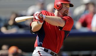 Washington Nationals' Chad Tracy hits a double against the Houston Astros during the fifth inning an exhibition spring training baseball game Thursday, March 7, 2013, in Kissimmee, Fla. (AP Photo/David J. Phillip)