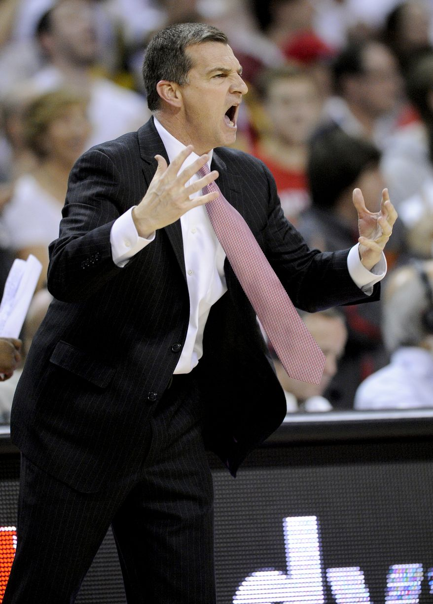 Maryland head coach Mark Turgeon reacts during the first half of an NCAA college basketball game against North Carolina, Wednesday, March 6, 2013, in College Park, Md. North Carolina won 79-68. (AP Photo/Nick Wass)