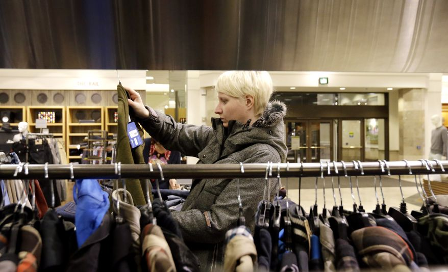 A shopper looks at clothing at a Nordstrom store in Chicago on Thursday, Jan. 10, 2013. (AP Photo/Nam Y. Huh)