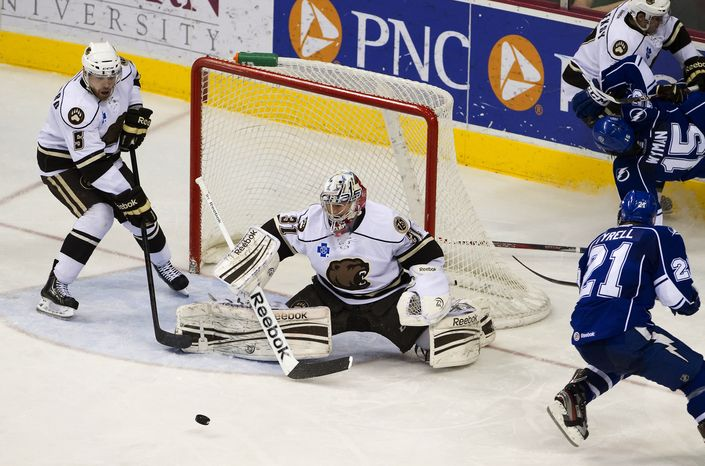 Hershey goalie Philipp Grubauer, center, and teammate Garrett Stafford helps defend the net in second period action during the AHL game in the Giant Center between the Syracuse Crunch and the Hershey Bears on Sunday, March 3, 2013. Bears went on to win the game 5 - 3. (AP Photo, Lebanon Daily News, Glen Gray)