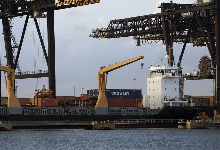 **FILE** A container ship is loaded with cargo in Fort Lauderdale, Fla., on Jan. 8, 2013. (Associated Press)