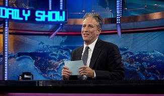 "Host Jon Stewart is seen here Oct. 18, 2012, during a taping of ""The Daily Show with John Stewart"" in New York. (Associated Press) **FILE**"