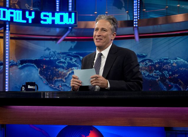 """Host Jon Stewart is seen here Oct. 18, 2012, during a taping of """"The Daily Show with John Stewart"""" in New York. (Associated Press) **FILE**"""
