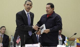 "**FILE** Venezuelan President Hugo Chavez (right) hands President Obama the book titled ""The Open Veins of Latin America"" by Uruguayan writer Eduardo Galeano at a UNASUR countries meeting during the Summit of the Americas in Port-of-Spain, Trinidad and Tobago. (Associated Press)"
