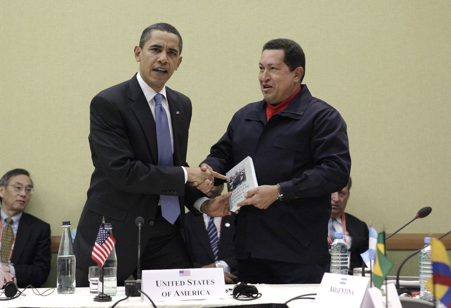 """**FILE** Venezuelan President Hugo Chavez (right) hands President Obama the book titled """"The Open Veins of Latin America"""" by Uruguayan writer Eduardo Galeano at a UNASUR countries meeting during the Summit of the Americas in Port-of-Spain, Trinidad and Tobago. (Associated Press)"""