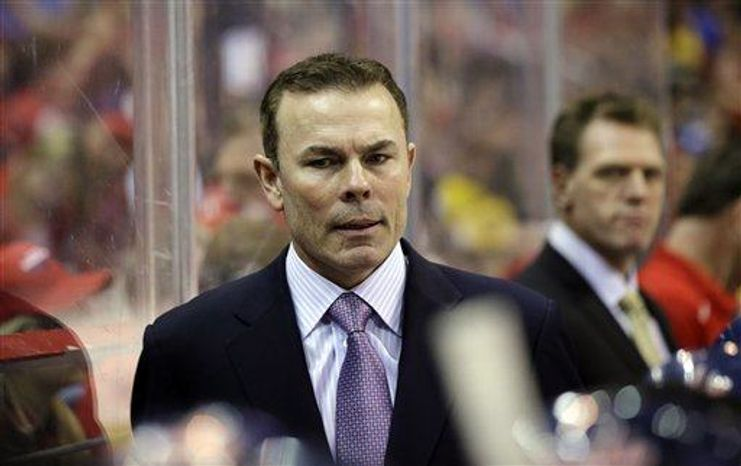 Washington Capitals head coach Adam Oates stands in the bench in the third period of an NHL hockey game against the Boston Bruins Tuesday, March 5, 2013 in Washington. The Capitals won 4-3 in overtime. (AP Photo/Alex Brandon)