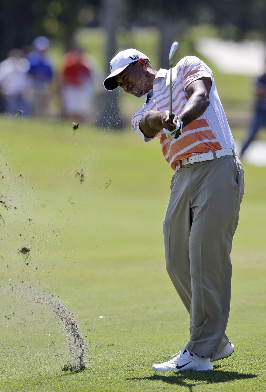 Tiger Woods hits from the third fairway during the second round of the Cadillac Championship golf tournament Friday, March 8, 2013, in Doral, Fla. (AP Photo/Wilfredo Lee)