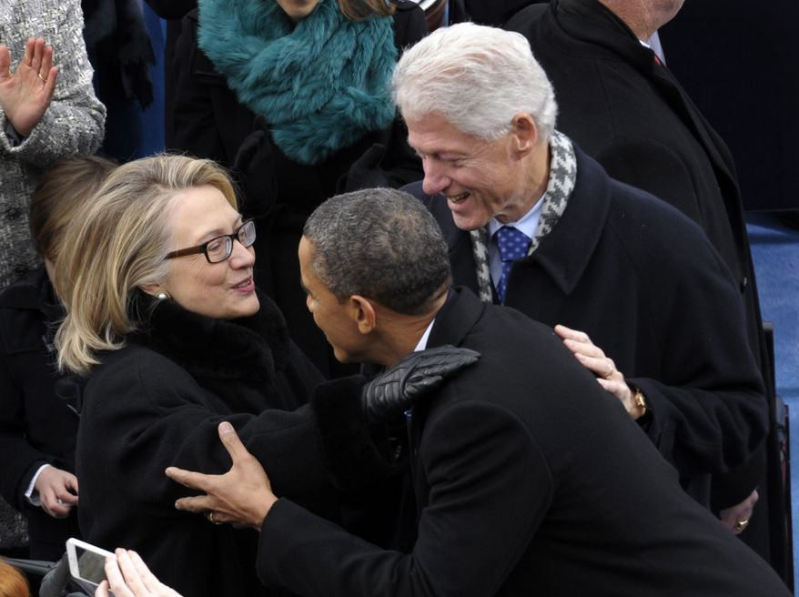 **FILE** President Obama is greeted by then-Secretary of State Hillary Rodham Clinton and former President Bill Clinton for his ceremonial swearing-in on Capitol Hill in Washington on Jan. 21, 2013, during the 57th Presidential Inauguration. (Associated Press)
