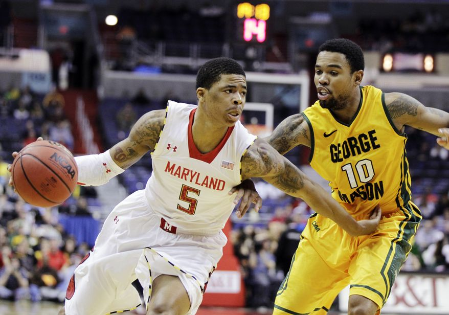 **FILE** Maryland's Nick Faust (5) drives against George Mason's Sherrod Wright (10) during the second half of an NCAA college basketball game at the BB&T Classic in Washington, Sunday, Dec. 2, 2012. Maryland won 69-62. (AP Photo/Luis M. Alvarez)