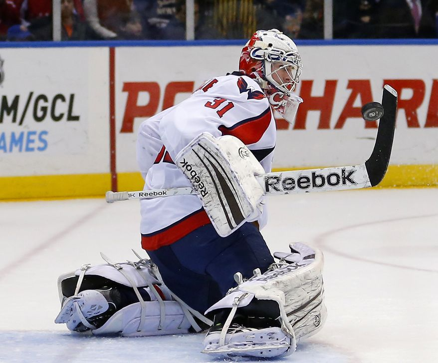Washington Capitals goalie Philipp Grubauer (31) makes a save during the second period of an NHL hockey game against the New York Islanders at Nassau Coliseum in Uniondale, N.Y., Saturday, March 9, 2013. (AP Photo/Paul J. Bereswill)