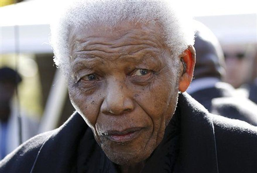 ** FILE ** Former South African President Nelson Mandela leaves the chapel after attending the funeral of his great-granddaughter Zenani Mandela in Johannesburg on June 17, 2010. (AP Photo/Siphiwe Sibeko, Pool)