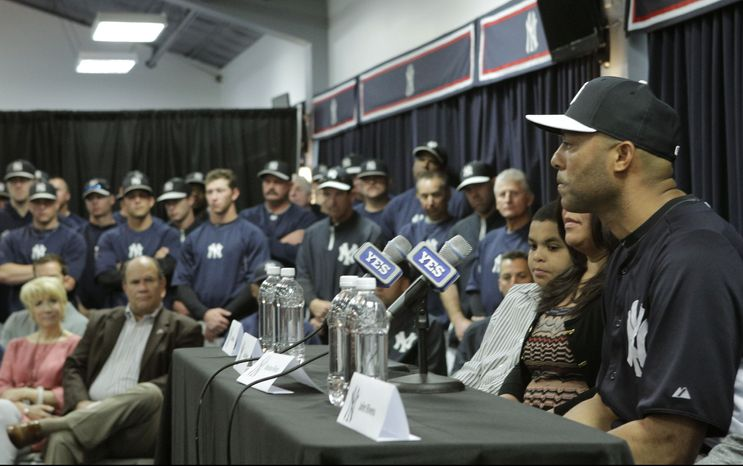 Yankees front office, coaches and teammates listen as New York Yankees pitcher Mariano Rivera, far right, who holds baseball's all-time saves record, announces his plans to retire at the end of the 2013 season during a news conference at Steinbrenner Field Saturday, March 9, 2013 in Tampa, Fla. (AP Photo/Kathy Willens)