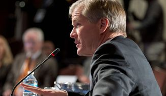 """Virginia Gov. Bob McDonnell is likely to sign some form of a transportation plan but decisions on other bills are less clear. """"[H]e's going to be confronted with criticism no matter which direction he's gone,"""" political analyst Bob Holsworth says. (Associated Press)"""