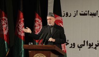Afghan President Hamid Karzai gives a nationally televised speech about the state of Afghan women in Kabul, Afghanistan, on Sunday, March, 10, 2013. Mr. Karzai also accused the Taliban and the U.S. of working in concert to convince Afghans that violence will worsen if most foreign troops leave as planned by the end of next year. (AP Photo/Ahmad Jamshid)