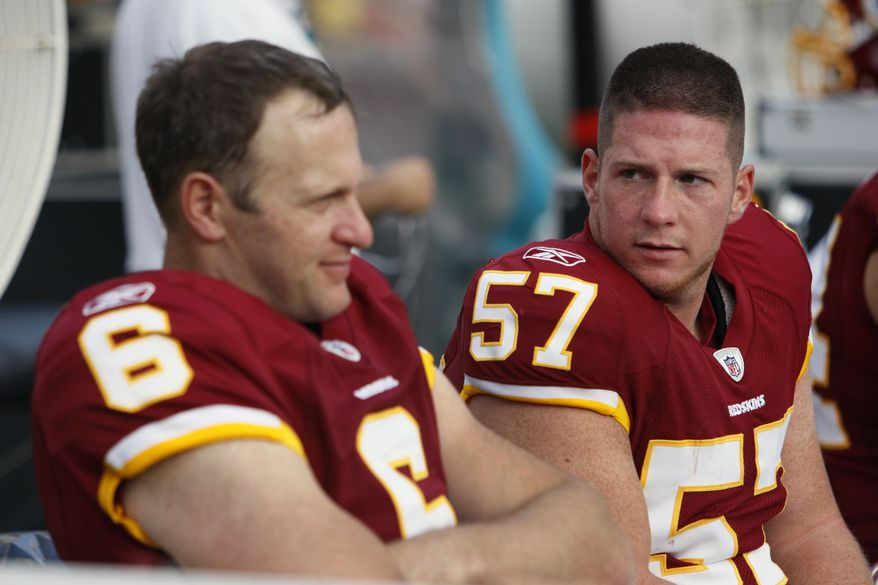 Washington Redskins long snapper Nick Sundberg (57) talks with punter Sav Rocca (6) during the second half an NFL football game against the Miami Dolphins, Sunday, Nov. 13, 2011, in Miami. The Dolphins defeated the Redskins 20-9. (AP Photo/Wilfredo Lee)