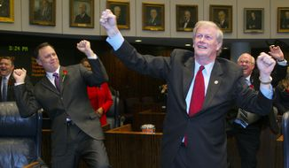 "Florida state Sens. Tom Lee,  John Thrasher and Alan Hays (right) do their versions of the ""Harlem Shake"" at the conclusion of an afternoon session of the Florida Senate on Tuesday, March 5, 2013, in Tallahassee, Fla. (AP Photo/Phil Sears)"