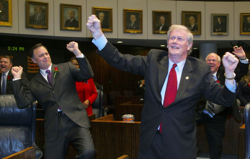 """Florida state Sens. Tom Lee,  John Thrasher and Alan Hays (right) do their versions of the """"Harlem Shake"""" at the conclusion of an afternoon session of the Florida Senate on Tuesday, March 5, 2013, in Tallahassee, Fla. (AP Photo/Phil Sears)"""