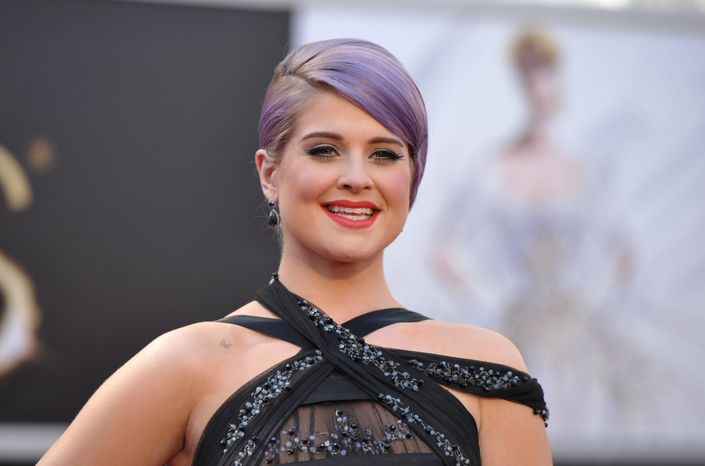TV personality Kelly Osbourne arrives at the 85th Academy Awards at the Dolby Theatre in Los Angeles on Sunday, Feb. 24, 2013. (John Shearer/Invision/AP)
