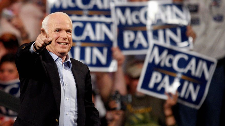 ** FILE ** Then-Republican presidential candidate Sen. John McCain points toward the crowd during a rally in Henderson, Nev., in 2008. Mr. McCain agreed to take public financing of his campaign and was limited to $84 million. (Associated Press)