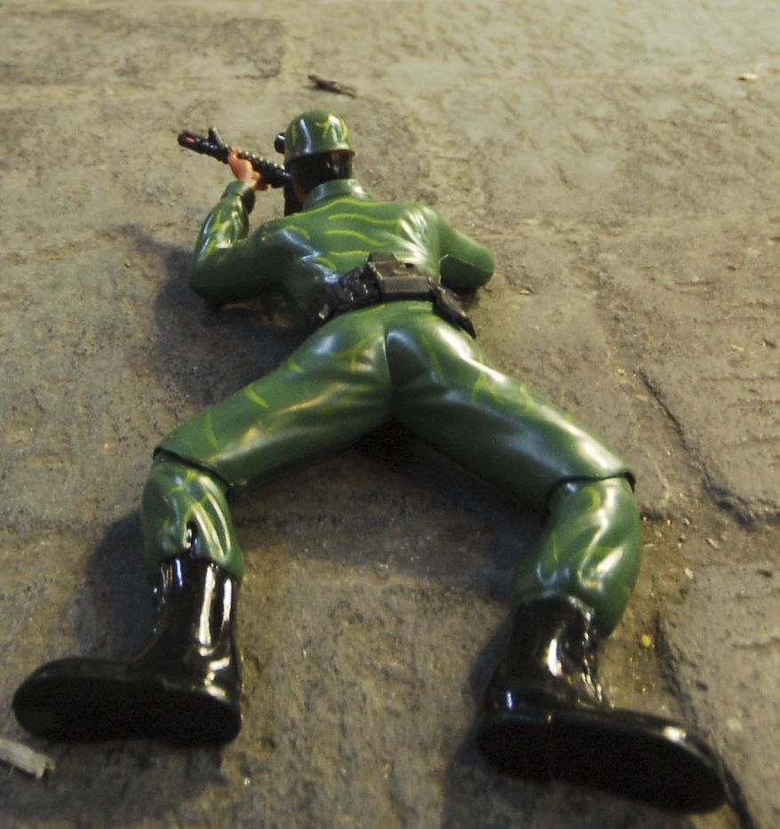 **FILE** A toy soldier is seen displayed on the ground by a street vendor at Hamidiyeh popular market, in the old city of Damascus, Syria, on Aug. 29, 2011. (Associated Press)