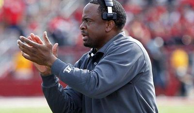 **FILE** Howard head coach Gary Harrell shouts from the sidelines during the first half of an NCAA college football game against Rutgers at Highpoint Solutions stadium Saturday, Sept. 8, 2012, in Piscataway, N.J. Rutgers won 26-0. (AP Photo/Mel Evans)