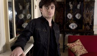 "British actor Daniel Radcliffe poses for photographs following an interview to discuss his role in ""Harry Potter and the Deathly Hallows, Part 1"" in 2010. (AP Photo/Joel Ryan)"
