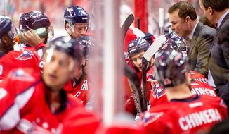 Washington Capitals head coach Adam Oates, right, draws up a play at the end of the second period as the team gets a power play as the Washington Capitals play the New York Rangers at the Verizon Center, Washington, D.C., Sunday, March 10, 2013. (Andrew Harnik/The Washington Times)